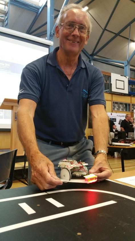 David Hannaford of the King Edward Vi School Robotics Club shows off his line-following bot