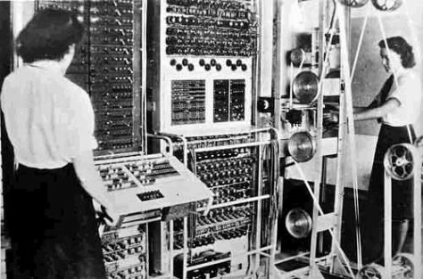 A Colossus Mark 2 computer being operated by Dorothy Du Boisson (left) and Elsie Booker (courtesy The National Archives)