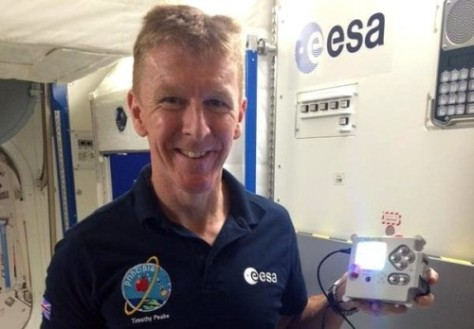 Tim Peake with a specially-cased Astro Pi (pic European Space Agency)