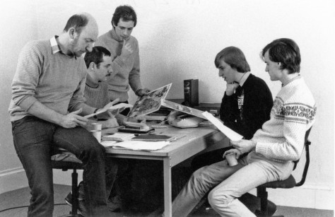 'Crash' Editorial team meeting in 1984 at the King Street premises, 1st floor. L to R: David Western (designer, page layouts), Roger Kean, Oliver Frey, Matthew Uffindell (staff reviewer), Kevin Foster (assistant editor)