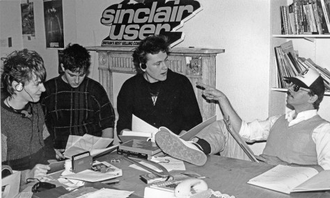 Zzap Editorial team, 1st floor King Street, c.November 1985. L to R: Julian Rignall, Gary Liddon, Gary Penn, Roger Kean – note the Sinclair user logo, stolen off the side of the EMAP stand at the recent PCW Show.